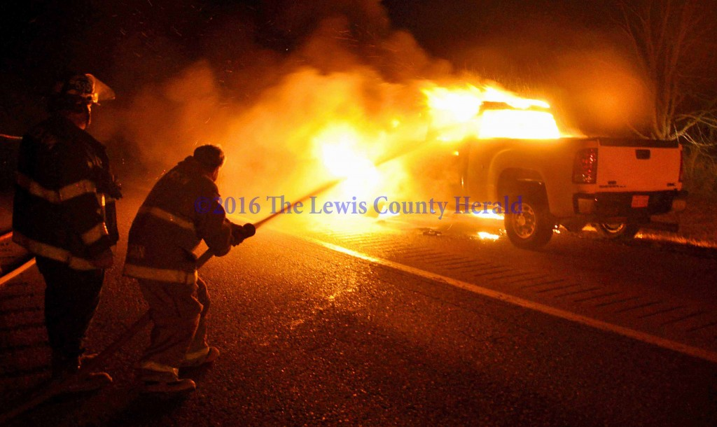Firefighters work to extinguish a vehicle fire on the AA Highway at Garrison. - Photo by Dennis Brown