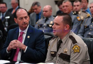 Lewis County Sheriff Johnny Bivens speaks before the House Judiciary Committee in Frankfort. State Representative Rocky Adkins (left) is a member of that committee. - LRC Photo