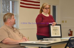 Angie Potter displays the certificate designating Lewis County as a Work Ready Community in Progress as Chamber of Commerce President John Grabill looks on. - Photo by Dennis Brown