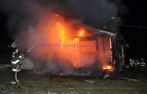 Firefighers battle a house fire in Garrison. - Photo by Dennis Brown