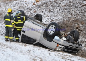 Tollesboro Fire and Rescue personnel on the scene of a single vehicle accident Thursday morning on the AA Highway at Heron Hill. - Photo by Dennis Brown