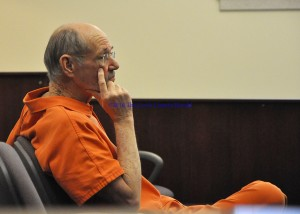 Duncan Aker Jr. waits for his hearing to begin Friday afternoon in Lewis Circuit Court. - Photo by Dennis Brown