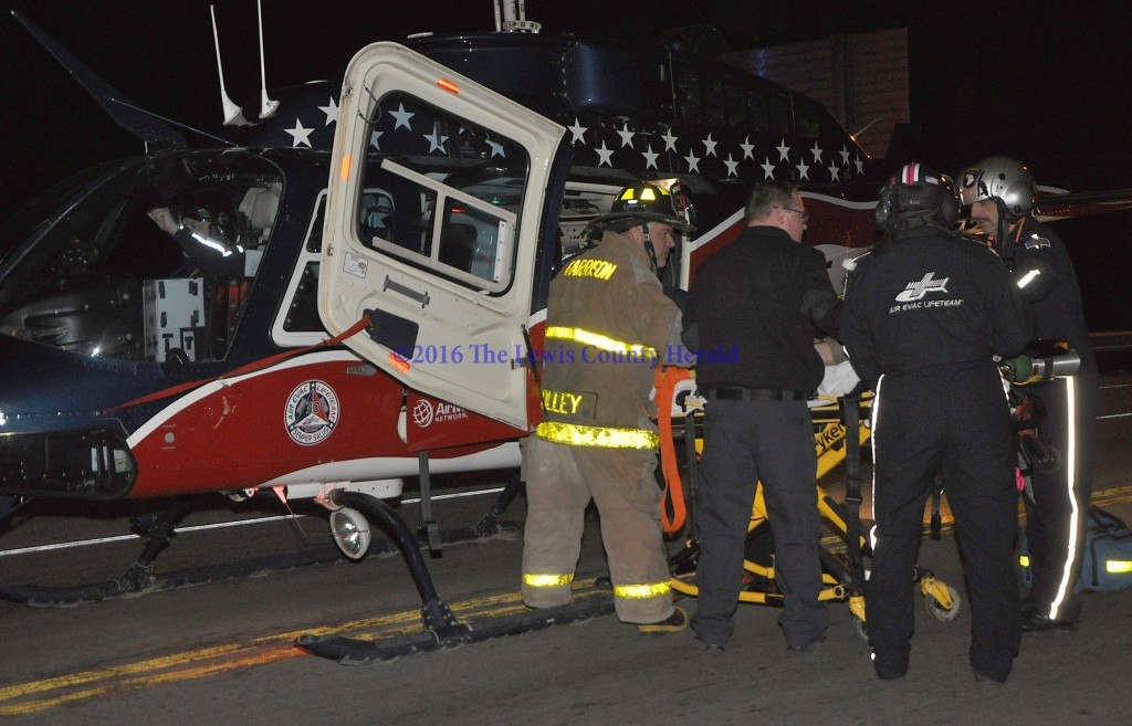 Rescue workers prepare to load an accident victim into an Air Evac medical helicopter Wednesday evening. The accident victim, a Greenup County woman, was taken to a trauma center in Huntington, West Virginia, for treatment. - Photo by Dennis Brown