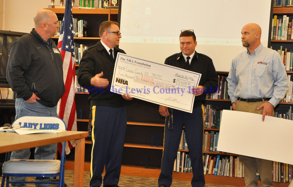 Lewis County Friends of NRA Chairman Kenny Ruckel, Chief Hilger, Sergeant Stone, and Kentucky NRA Field Representative John LaRowe. NRA Grant awarded to LCHS JROTC, $5,409.50. - Photo by Dennis Brown