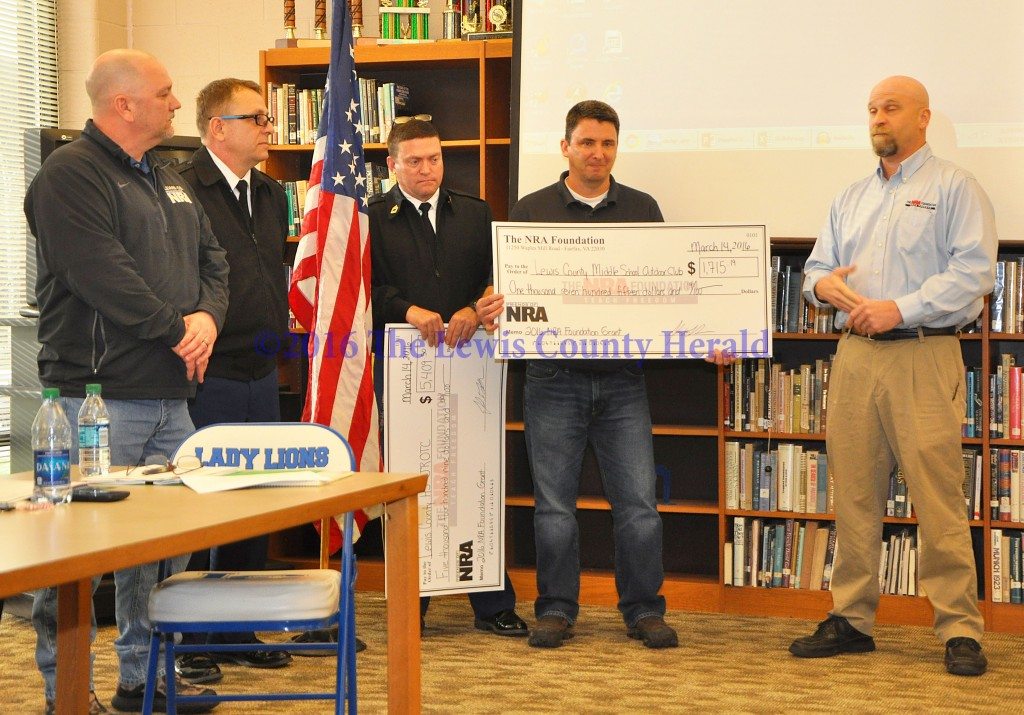 Lewis County Friends of NRA Chairman Kenny Ruckel, Chief Hilger, Sergeant Stone, LCMS teacher John Liles representing the LCMS Outdoor Club, and Kentucky NRA Field Representative John LaRowe. Amount awarded was $1,715.19. - Photo by Dennis Brown