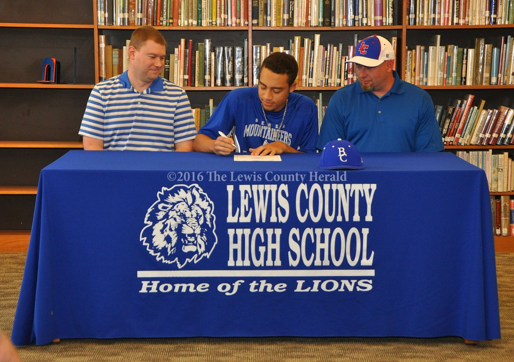 Jalen Prater signs a letter of intent with the Berea College Mountaineers as LCHS Assistant AD Josh Hughes and Baseball Coach David Kelley look on. - Photo by Dennis Brown