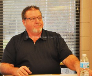 Bryan McRoberts conducts a meeting of the Lewis County Board of Education Monday evening. - Photo by Dennis Brown