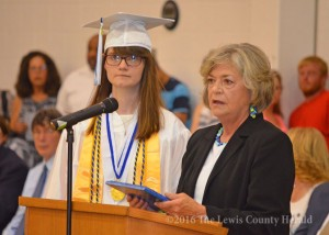 Superintendent Belinda Forman presents Laura Beth Thomas a special award for 14 years of perfect attendance. The recognition came during LCHS commencement exercises Friday evening. - Photo by Dennis Brown