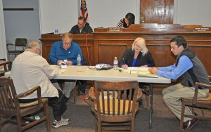 Election officials tally votes in Tuesday's Primary Election. - Photo by Dennis Brown