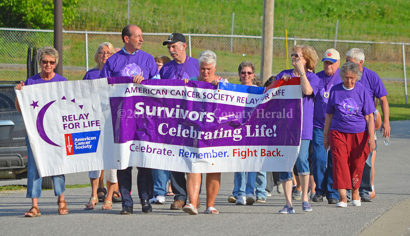 Cancer survivors walk during the Lewis County Relay for Life event on Friday. - Photo by Dennis Brown