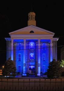 The Lewis County Courthouse is illuminated in blue in honor of local law enforcement.