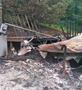 This mobile home was destroyed by fire early Wednesday. Assistance is being sought for the resident.