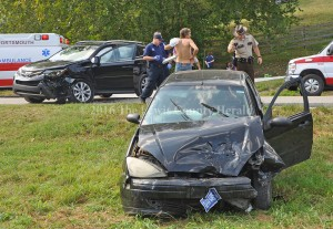 Deputy Matt Ross photographs an accident scene Thursday afternoon on Ky. Rt. 344. - Photo by Dennis Brown