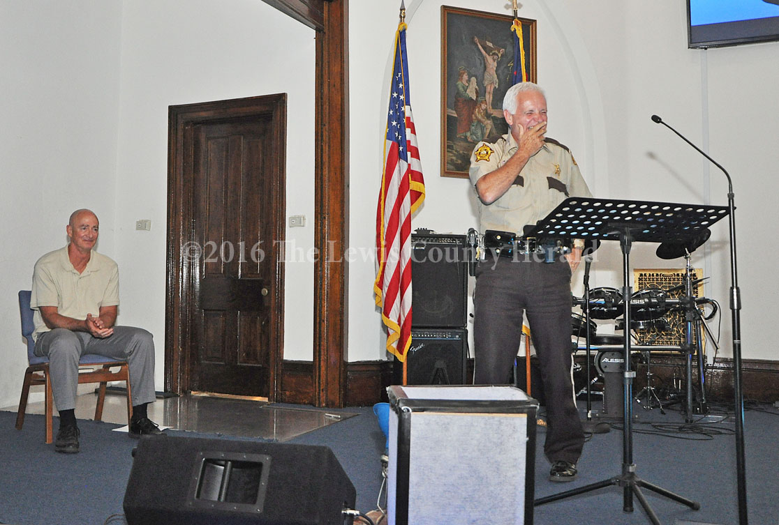 Deputy John Byard reacts after telling a story about Vanceburg Christain Church Pastor Tom Cox (at left). Byard officiated the wedding ceremony for Tom and Karen Cox. - Photo by Dennis Brown