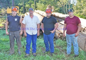 Derrick, Rick, Allen and Randy Butler comprise Butler and Sons Logging. The company has been named Logger of the Year by Glatfelter. - Dennis Brown Photo