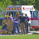 First responders prepare to transfer a Vanceburg teen to a waiting medical helicopter following a four-wheeling accident Saturday afternoon. - Photo by Dennis Brown