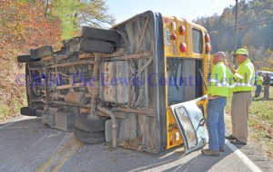 Workers with the Kentucky Department of Transportation examine a school bus following an accident Wednesday afternoon on Ky. Rt. 59 south of Vanceburg. - Dennis Brown Photo