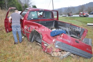 Deputy Eric Poynter examines the scene of a single vehicle accident that injured a Vanceburg teen. - Dennis Brown photo
