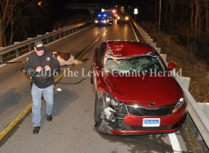 Deputy Gary Erwin examines the scene of an accident early Sunday on Ky. Rt. 8 at Quincy. - Dennis Brown Photo