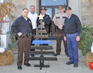 A Thin Blue Line Christmas tree is presented to local law enforcement by Danny Rowe. Pictured, left to right, are Sheriff Johnny Bivens, Judge Executive Todd Ruckel, Deputy Teresa Lewis, Deputy Matt Ross and Danny Rowe. - Dennis Brown Photo