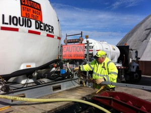 A state road worker prepares a brine mixture that will be applied to roadways in advance of predicted wintry weather.
