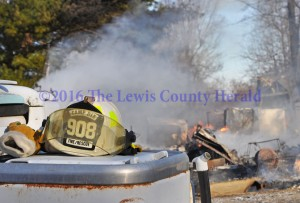 Firefighters were called to Old Trace Hill Road Thursday when a home there was reported on fire. The home was destroyed in the fire which also resulted in an apparent death. - Dennis Brown Photo