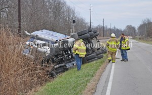 Firefighters examine the scene of a tanker truck accident Thursday afternoon on Ky. Rt. 8 just east of Quincy. The accident resulted in some evacuations and the road closure. - Dennis Brown Photo