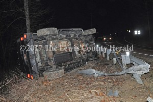 No one was hurt Monday evening when this Hummer traveled through a guardrail and overturned onto its side. - Dennis Brown Photo