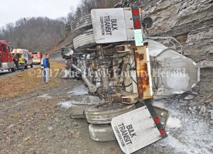 Lewis County Judge Executive Todd Ruckel and Garrison Fire Chief Marty Strong look over the scene of an accident involving a load of bulk lime. No one was hurt in the accident. - Dennis Brown Photo