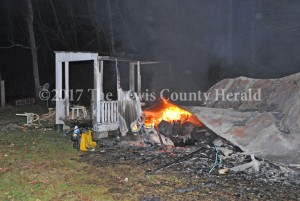 A porch is about all that remains following a mobile home fire on Twin Branch Saturday night. - Dennis Brown Photo