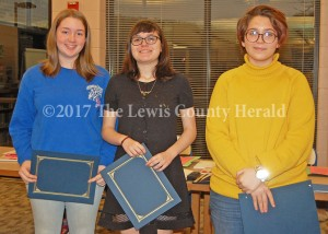 These LCHS students were recognized for their accomplishments during a meeting of the Lewis County Board of Education Monday. Pictured, left to right, are Sarah Walker, Katelyn Carver and Hope Lewis. Each was named a grade-level winner in the annual Ohio River Sweep poster contest. - Dennis Brown Photo