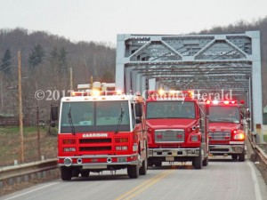 Garrison Fire and Rescue trucks cross the Blue Bridge at Garrison a final time. The bridge closes to all traffic today. It will be replaced by a new bridge. - Karen Killen Photo