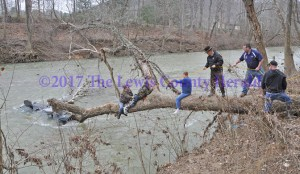 Two men were rescued after their boat nearly capsized in rain swollen Kinniconick Creek. - Dennis Brown Photo