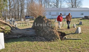 Lewis County Emergency Management Director George Sparks (right) and Ken Haydu, Meteorologist in Charge with the National Weather Service Office in Wilmington, Ohio, survey storm damage at Mt. Zion Ridge on Friday. - Dennis Brown Photo