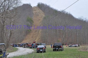 Several volunteers, family members, and search crews on Saturday afternoon where missing Vanceburg man's truck was found. (The red pick-up is visible at the base of the hill on a gas pipeline right-of-way.) - Dennis Brown Photo