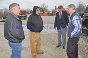 Officials discuss the connection of a rail spur in Garrison to serve a new tie yard there. Pictured, left to right, are County Road Supervisor Bob Moore, Tram President Terry LeMaster, County Attorney Thomas M. Bertram II, and Judge Executive Todd Ruckel. - Dennis Brown photo