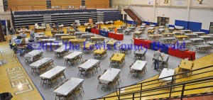Volunteers set up for the annual Lewis County Friends of NRA Banquet at Lewis County Middle School. - Dennis Brown Photo