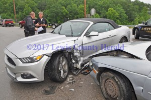 Deputy Matt Ross is investigating a two-vehicle accident at the intersection of the AA Highway and Grayson Spur on Thursday afternoon. No one was seriously hurt in the crash. - Dennis Brown Photo