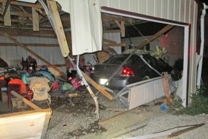 This garage in Garrison sustained extensive damage early Monday when an auto crashed through it.