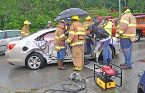 Rescue workers tend to an elderly couple following an accident in Vanceburg Tuesday afternoon. Both were taken to the hospital. - Dennis Brown Photo