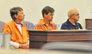 Preston Neill Walters, left, and Wince Walters sit with Lewis County Jailer Jeff Lykins as they wait for their appearance in Lewis District Court. - Dennis Brown Photo