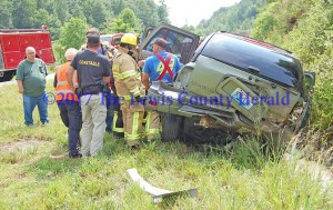 Rescue workers tend to an injured person following a crash on the AA Highway east of Vanceburg on Friday afternoon. - Dennis Brown Photo