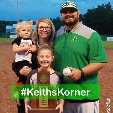 Coach Keith Prater and his family pose with the District Baseball Championship Trophy he and his Rowan County team won.