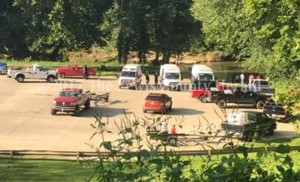 First responders assemble at the Garrison Boat Ramp as efforts are underway to reach three young men who were injured when the four-wheeler they were on plunged off a nearby railroad bridge. - Patricia Grigson Photo
