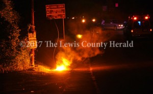 A live electric line fell to the ground as the result of a single vehicle accident on Main Street in Vanceburg late Saturday. The line arced for several minutes and power was disrupted for several Vanceburg residents. - Dennis Brown Photo