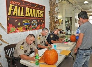 Officials process suspects during a drug roundup Friday. Pictured, left to right, are Sheriff Johnny Bivens, Deputy Bryon Walker, and Vanceburg Police Chief Joe Billman. - Dennis Brown Photo