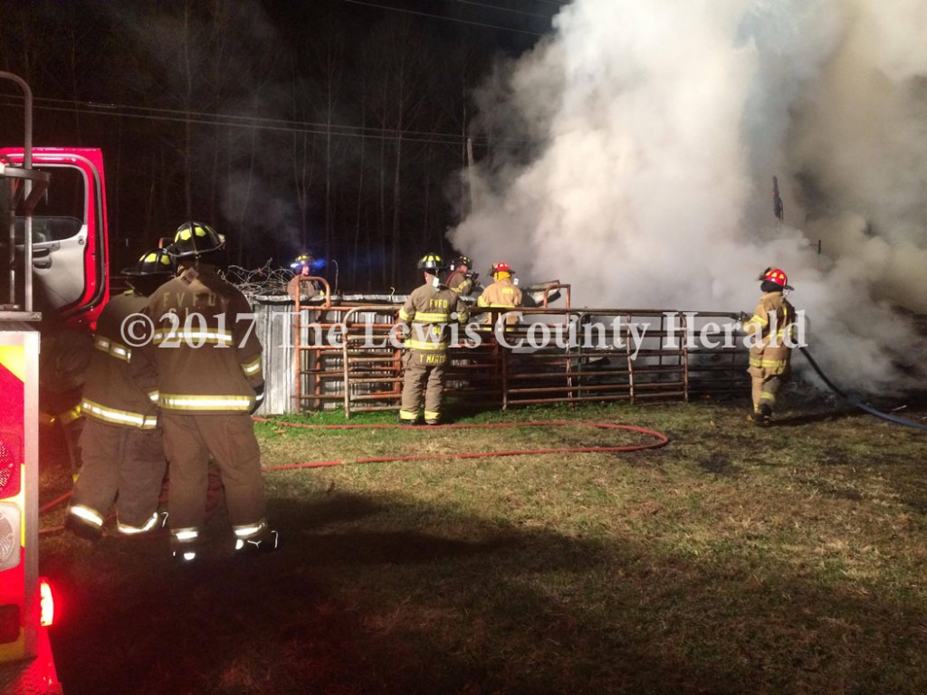 Firefighters from Garrison and Firebrick assisted Maloneton firefighters in battling a barn fire in Greenup County Wednesday night. - Hammer Cooper Photo