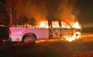 Deputy Bryon Walker is investigating this fire that destroyed a truck belonging to Mason County Fiscal Court as well as the theft of several tools from the Mason County Road Department. - George Sparks Photo