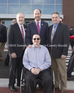 Officials on hand for the opening of MCTC's new Rowan Campus included Trace Creek Construction CEO Sam Howard (in front) and MCTC President Dr. Stephen Vacik, State Representative Rocky Adkins, and Lewis County Judge Executive Todd Ruckel (standing). - Tammie Brown Photo