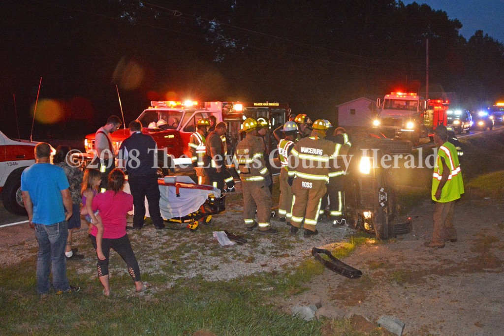 First responders work to remove the driver of an auto following an accident on Ky. Rt. 8 east of Vanceburg Saturday night. Roberta Colby, 25, of Garrison, was taken to the hospital for treatment of multiple injuries. - Dennis Brown Photo